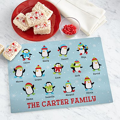 Playful Penguins Glass Cutting Board