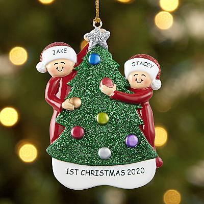 Family Decorating the Tree Bauble