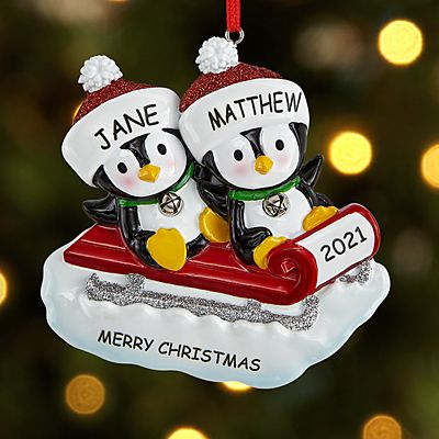 Sledding Penguin Couple Ornament